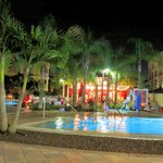 A night shot of the pool area