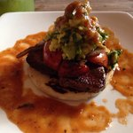Arepa with steak, guacamole, and lovely charred tomatoes