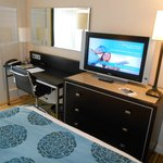 Small desk with ergonomic chair and Tv