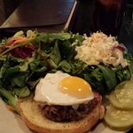 Pork burger with greens on the side