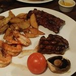 Mixed combo, 6 ounce rump steak,  king prawns and baby ribs. Steak and ribs were really tasty, s