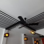 Detail reception fan and recurring design theme of wooden bars
