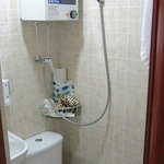 No promised bathtube, shower sprays over toilet and sink