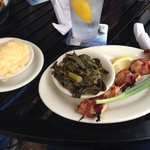 Bacon jalapeño wrapped shrimp, collard greens and grits