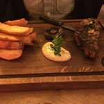 Fillet steak with bone in and dripping chips