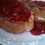 Yummy lemon cream stuffed French toast with raspberry sauce