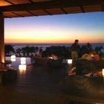 Secrets Lobby overlooking grounds, beach, sunset