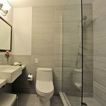 New Elegant Slate-Tiled Executive Bathrooms