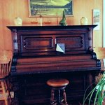 old piano in a lobby