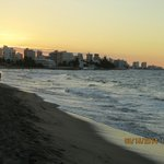 View of the beach area at sunset over San Juan