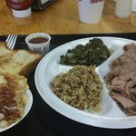 Pork and beef brisket plate with greens and red beans and rice. Peach cobbler too!