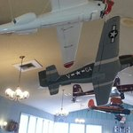 For the airplane buff model airplanes hang from the ceiling.