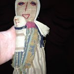 were not sure if its an old prairie doll hoping for your help thanks alot for your time ANNE