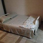 This was the bed with the thin, worn foam mattress and the painful metal bars