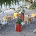 Dining area set up on the beach for dinner one night