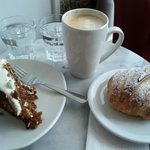 Carrot cake, almond croissant (both made on-site) and good latte