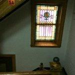 Лестница и витражные окна в отеле