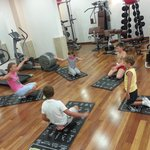 My kids in the group-based training held by the professional and excellent trainer in the gym