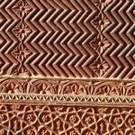 Closeup of red sandstone carving