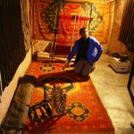 Khalid explaining the symbolism in Berber carpets