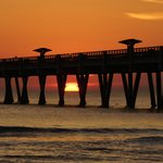 Sunrise behind the fishing pier