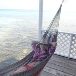 Hammock on porch over the water.