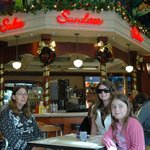 Me, my mum and my sister inside of the Disney Soda Fountain And Studio Store.