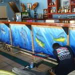 Artists working on mural at Mis Amigos.