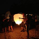 Wedding parties light Chinese lanterns on the beach at night