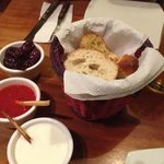 Garlic crostini with dipping sauces and olives