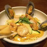 Our Wok Seafood Pasta comes with fresh mussels, shrimp and scallops.