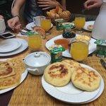 Wonderful breakfast....pistachio yogurt, breads, jams, eggs, fresh fruit - yum!