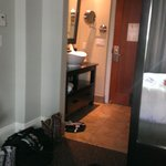 Sink and entrance as viewed from the bed.