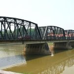 The iron bridge across the road allows easy access to the night market and central Chiang Mai