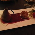 Poached pear in red wine sauce.