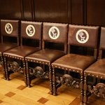 Chairs, inside the town hall, bearing the cotes of arms of Bremen