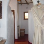 archway into spacious bathroom and ROBES!