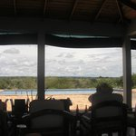 View of pool from open air lounging/bar/eating area