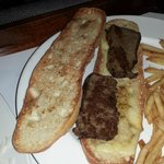 this  is a cheese baguette with sirloin steak notice the over cooked frise