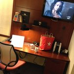 Room desk and coffee machine plus tv