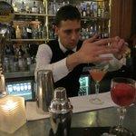Francesco preparing a cocktail