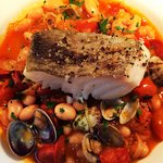 Grilled fillet of cod with chorizo, butter bean, cherry tomato and clam cassoulet
