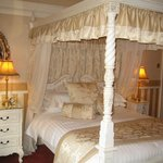 Room 3's four-poster bed