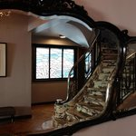 Lovely Art Deco staircase reflected in the entryway mirror.