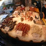 Mercato di Capo at a fish stall where all the guys knew Vincenzo and we tasted fresh neonata!