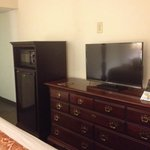 Microwave and fridge. TV and dresser