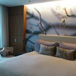 Bed with trendy artwork