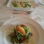 crispy duck egg with Black Forest ham, and scallop and salmon carpaccio
