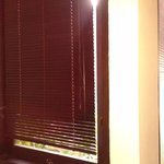 security light streaming through gap in blind