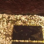green pebbles in shower base